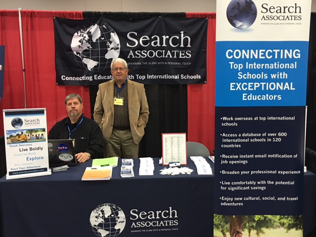 Michael Williams and Vince Pecchia, representing Search Associates, attract teachers to the world of international education