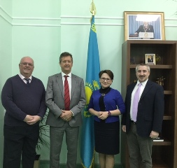 At  Miras International School, Astana. From left: Stephen Butlin, Secondary Principal; Senior Associate Bill Turner; Yelena Khamitova, Head of School; and Jared Tabita, Primary Principal