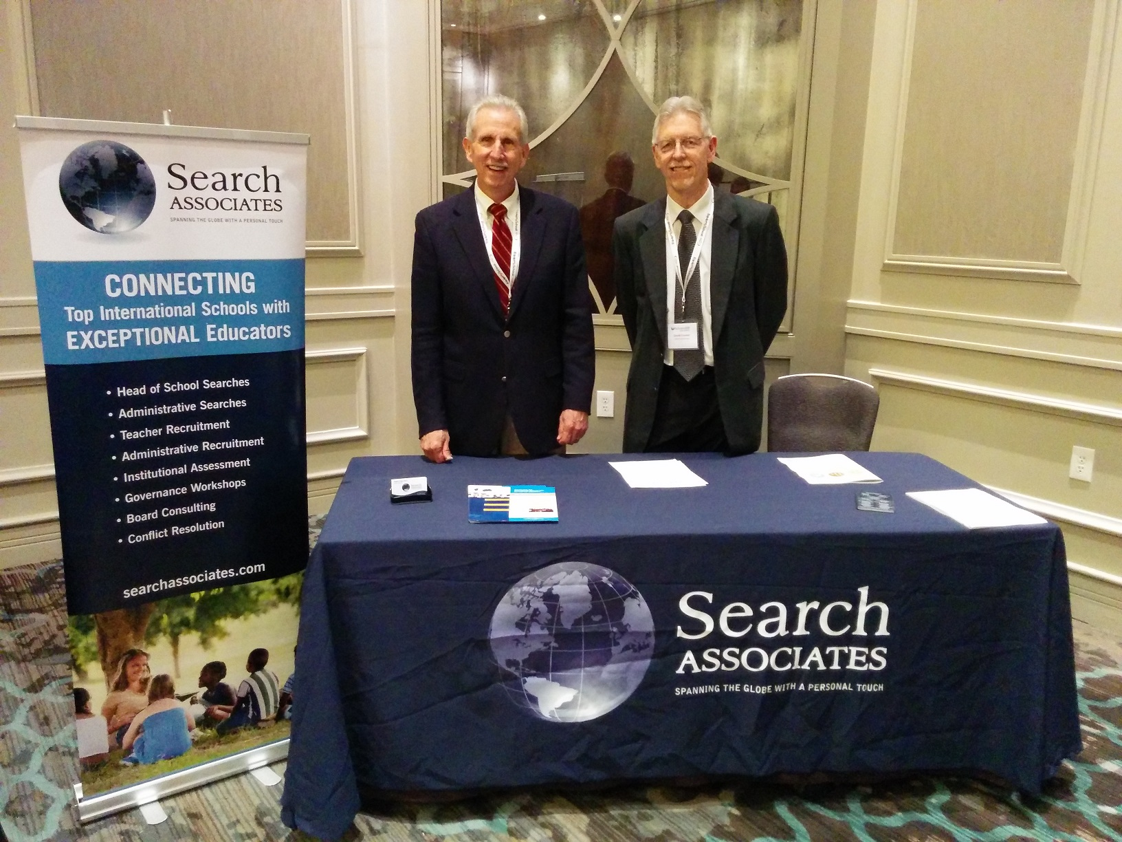 Senior Associates Ralph Jahr (L) and David Cramer (R) at the exhibitor table