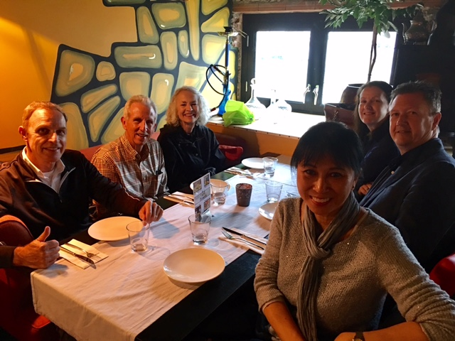 A group dinner outing with new Senior Associate Gary MacPhie and wife Barbara (front L and R)